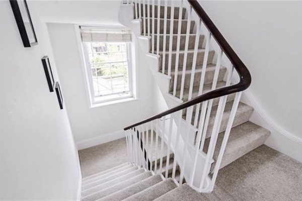 Long stairs with carpet styled by Absolute Project Management