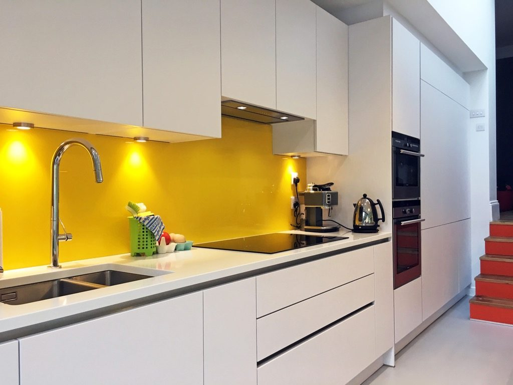Yellow featured wall behind the sink styled by Absolute Project management