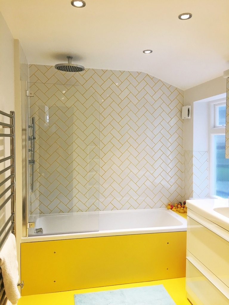 Brightly styled bathroom by Absolute Project Management