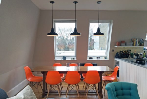 Bright coloured chairs in the dining space styled by Absolute Project Management
