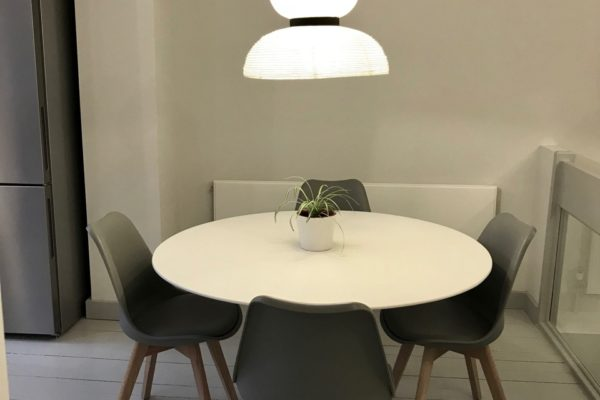 circle table and grey chairs styled by Absolute project management