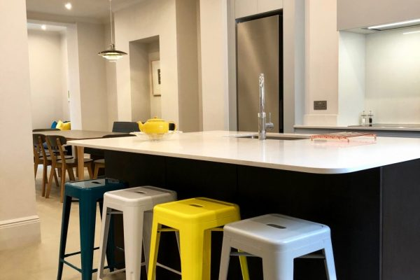 Bright pendant lights and downlights used in the kitchen and in the dining space styled by Absolute Project Management