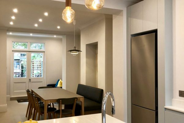 White marble countertop and dark grey cupboards styled by Absolute Project Management