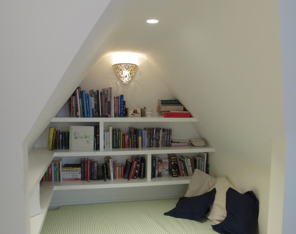 Cosy nook with recessed downlight and wall lighting