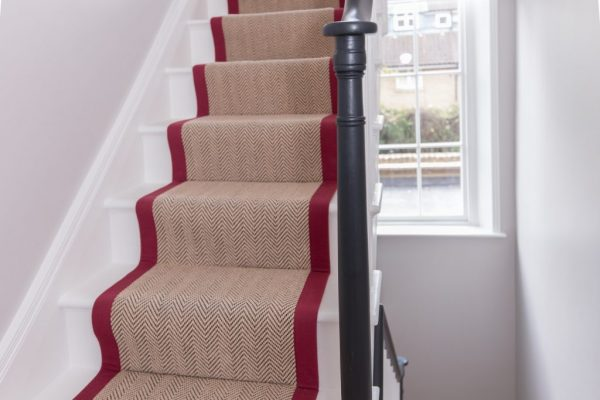 Stairs with nice beige and red carpet styled by Absolute Project Management