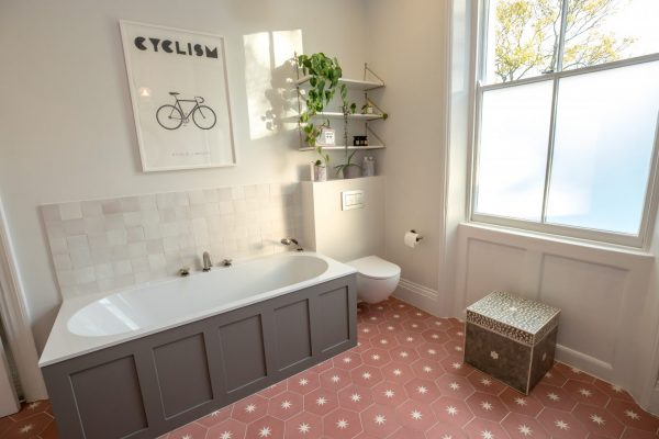 Modern bathroom and brick red floor tiles styled by Absolute Project Management