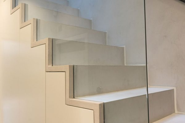 Modern stairs and glass balustrades styled by Absolute Project Management