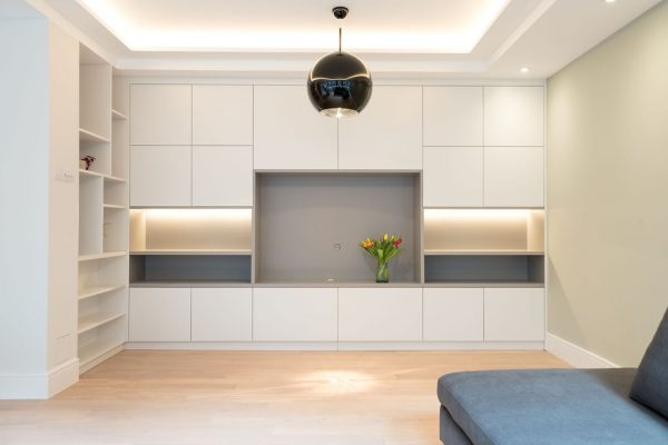 Large storage system in the living room styled by Absolute Project Management