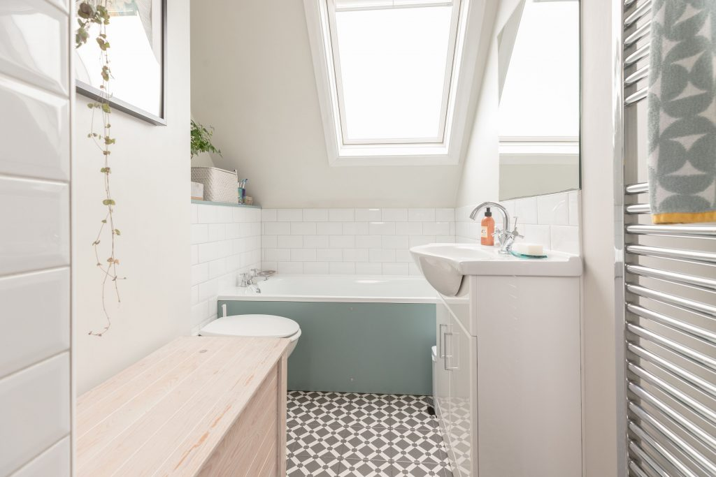 Bright bathroom with monochrome tiles styled by Absolute Project Management