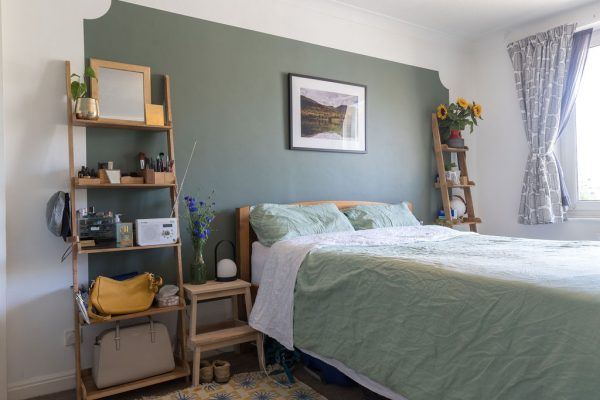 Bedroom in Hove with smart green feature wall - designed and styled by Absolute Project Management