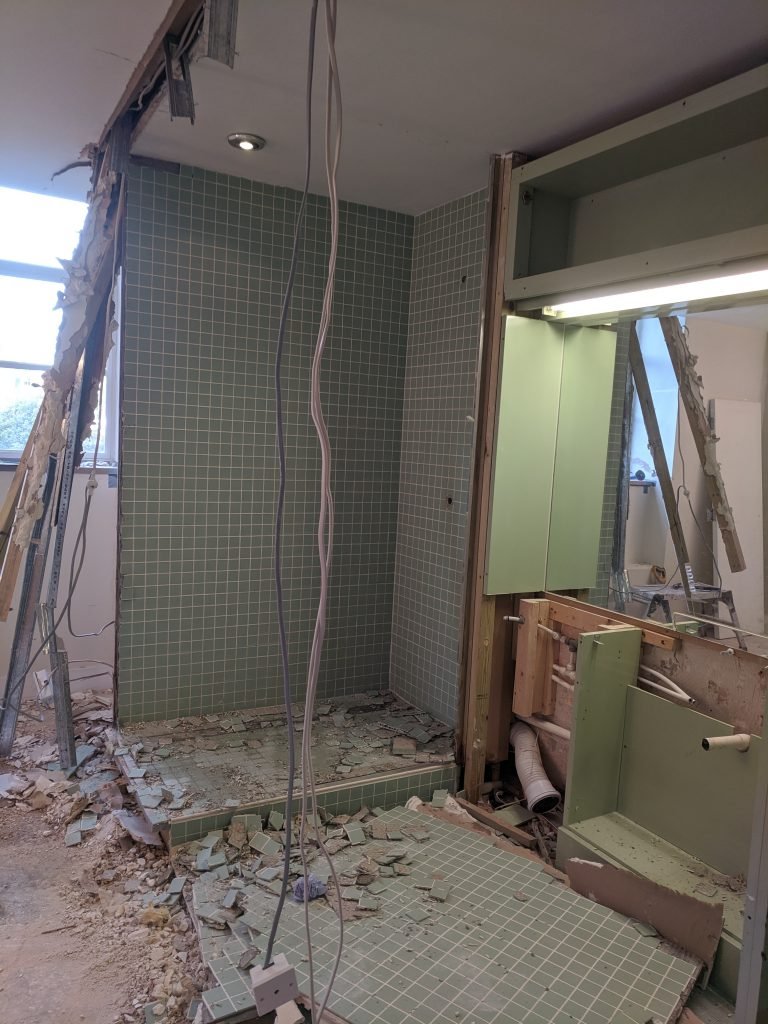 Bathroom in part demolished flat