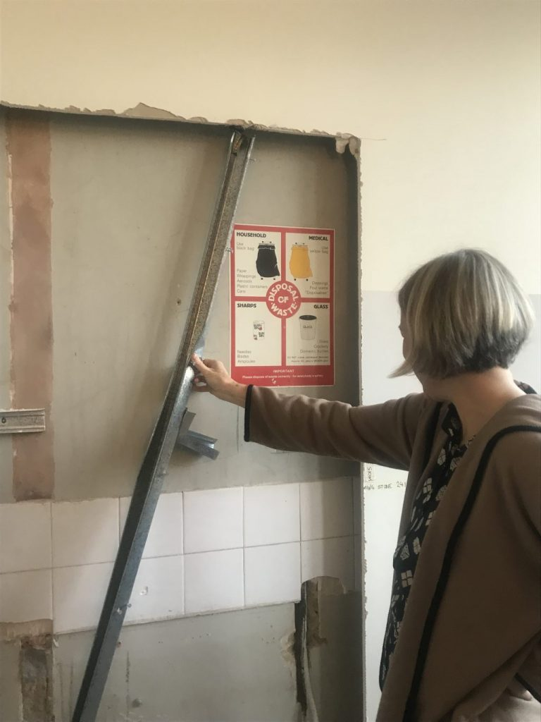 Safe Waste Disposal Poster on wall revealed behind plasterboard on building site