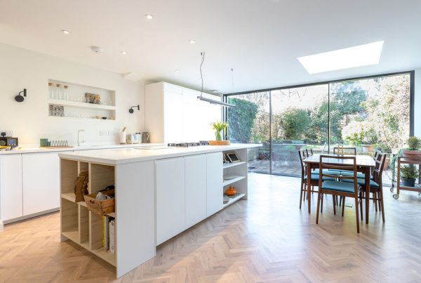 All white kitchen contemporary kitchen with beautiful natural light. Renovation by APM.