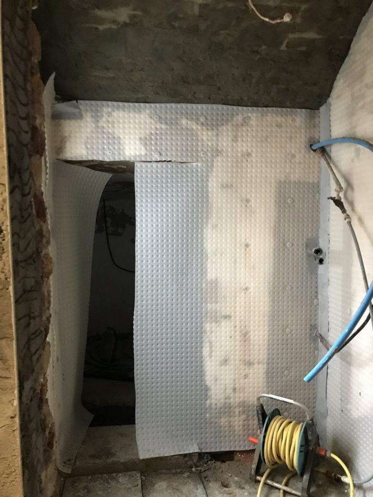 Damp proof membrane in the process of being fitted