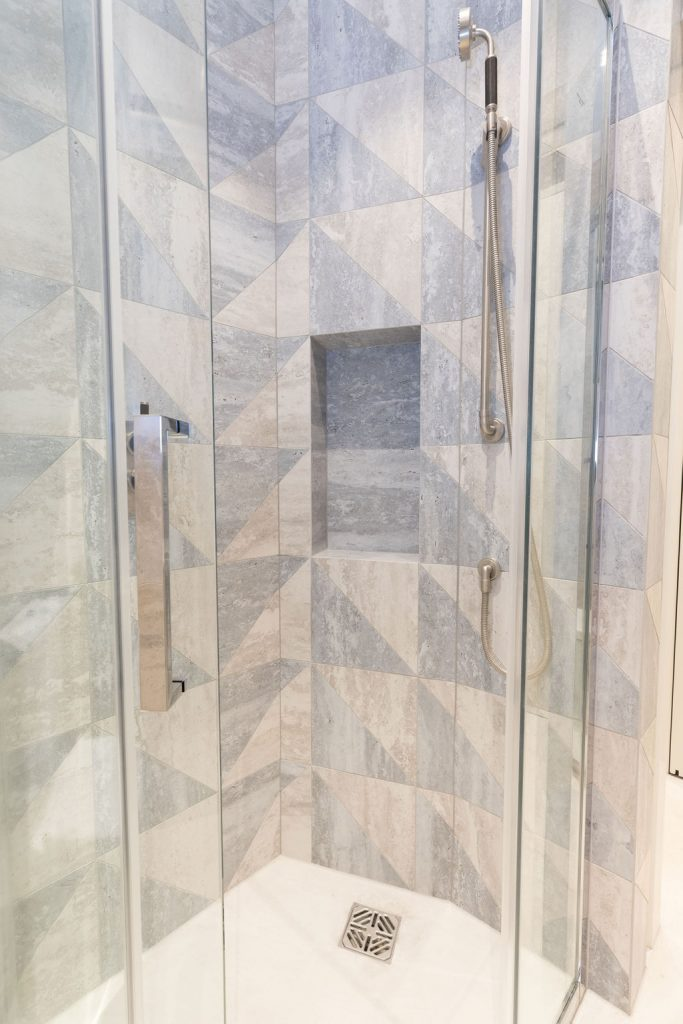 Shower enclosure with curved door, Samuel Heath fittings and storage niche - by Absolute Project Management