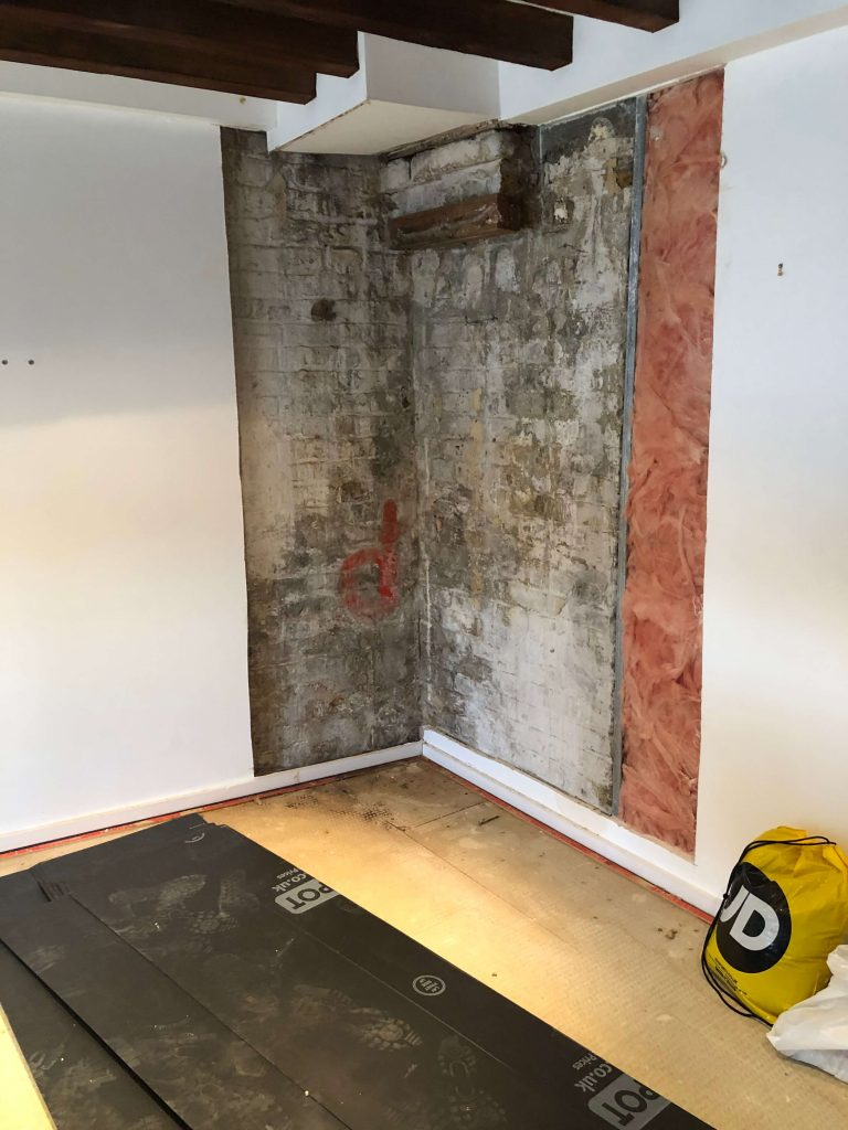 Internal wall in with damp-proofing treatment in progress