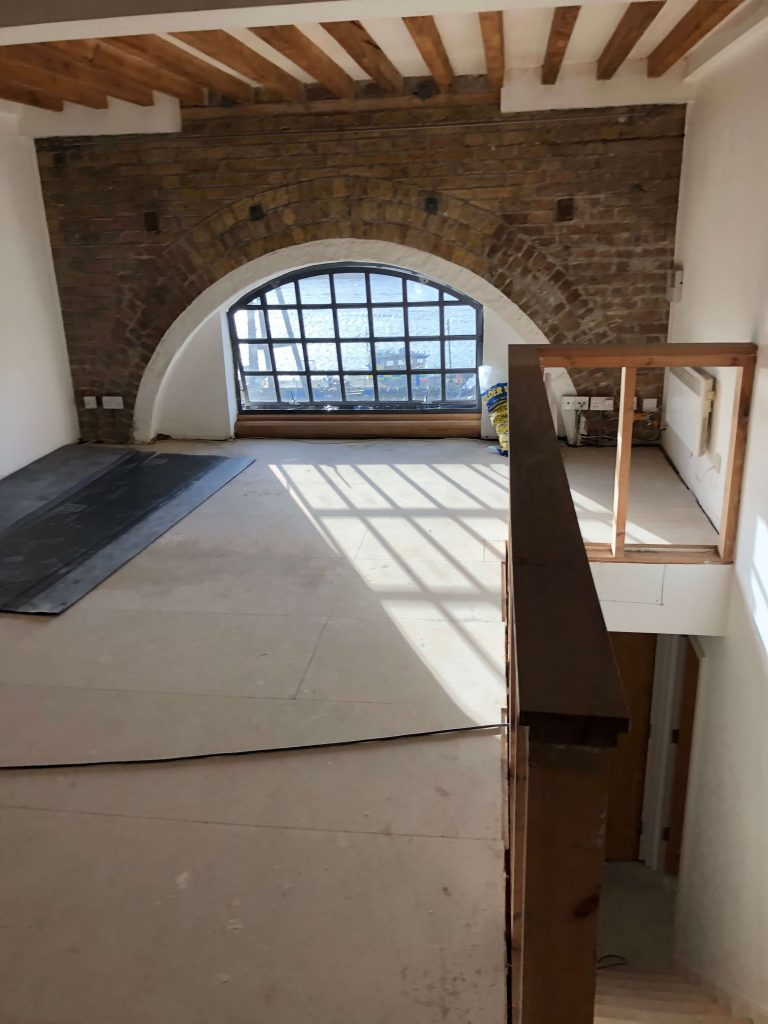 Wharf flat with arched windows