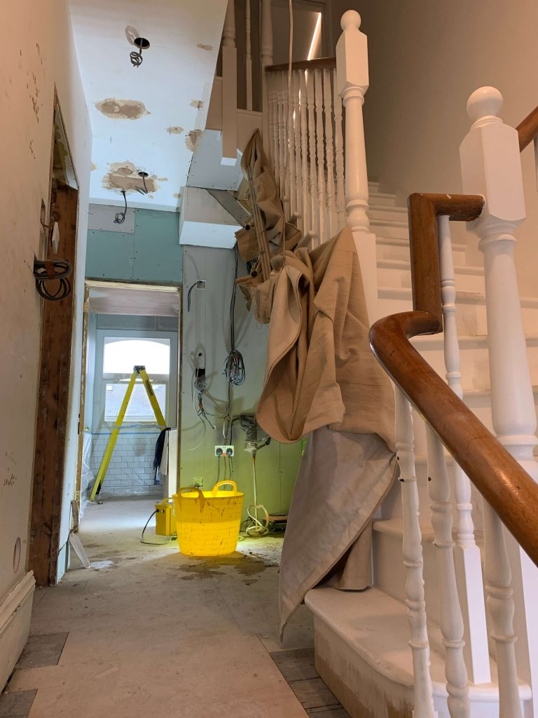 Staircase in mid-renovation townhouse