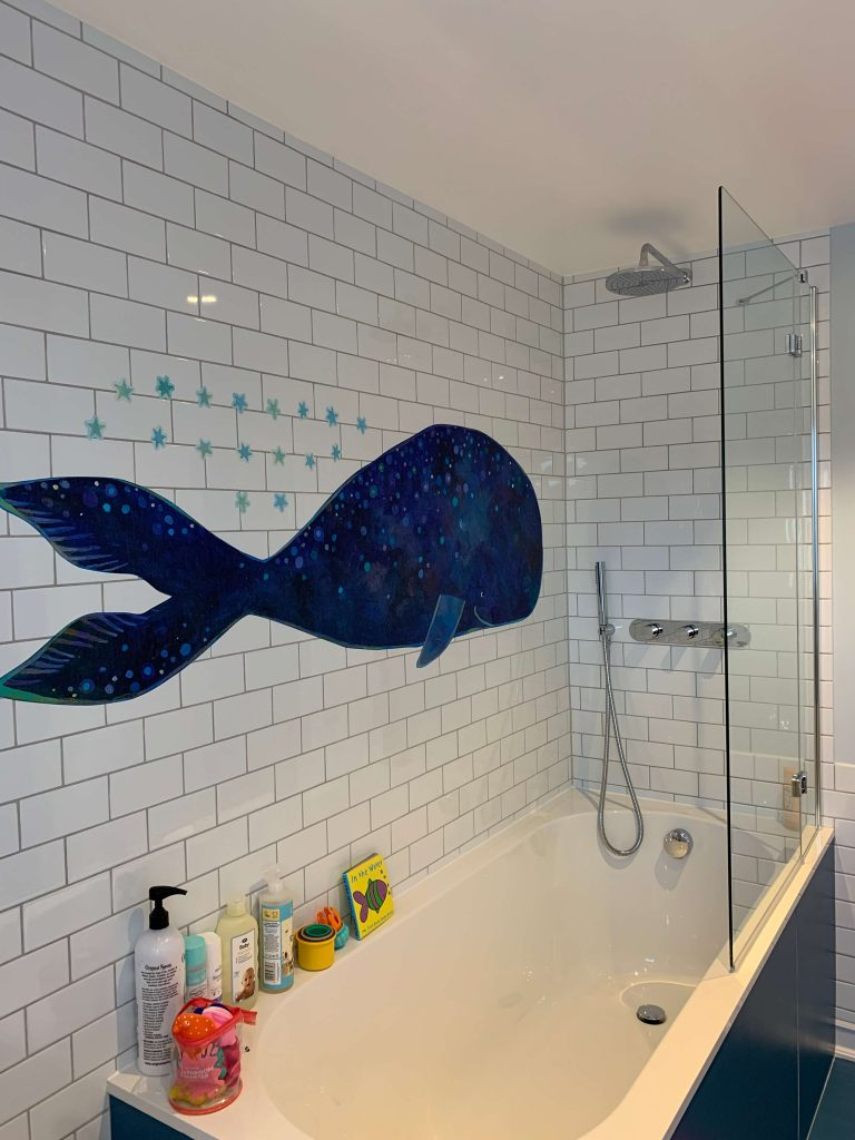Bathroom with blue whale decal