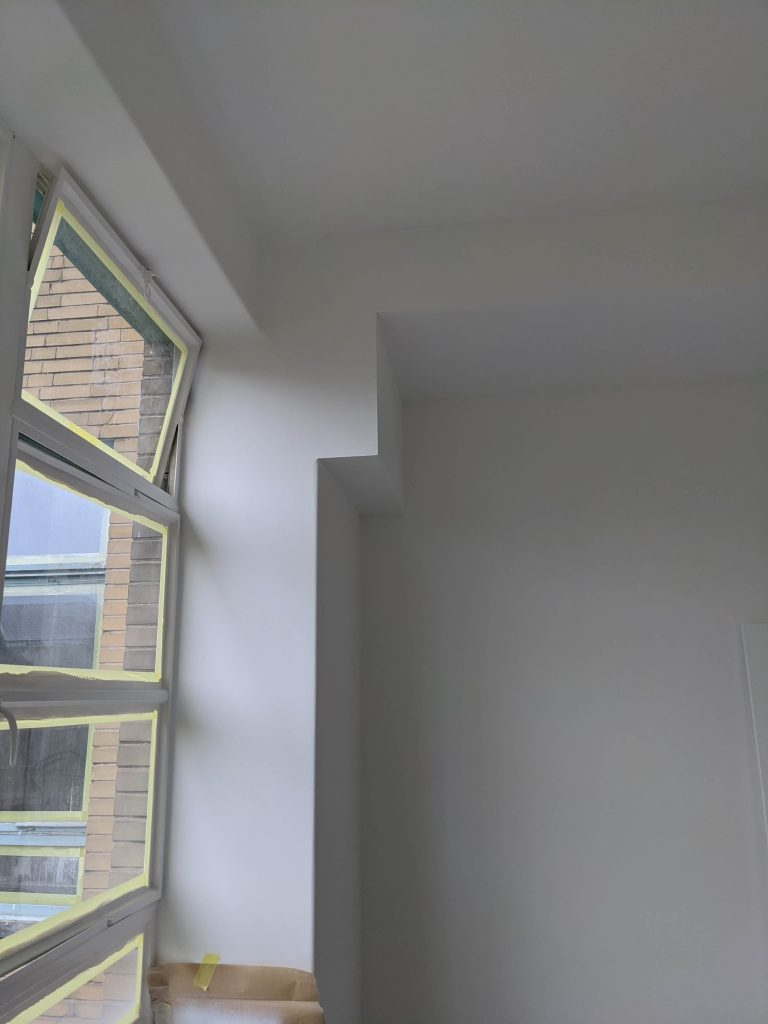 Boxing to neatly conceal ventilation ducts in flat being renovated by Absolute Project Management