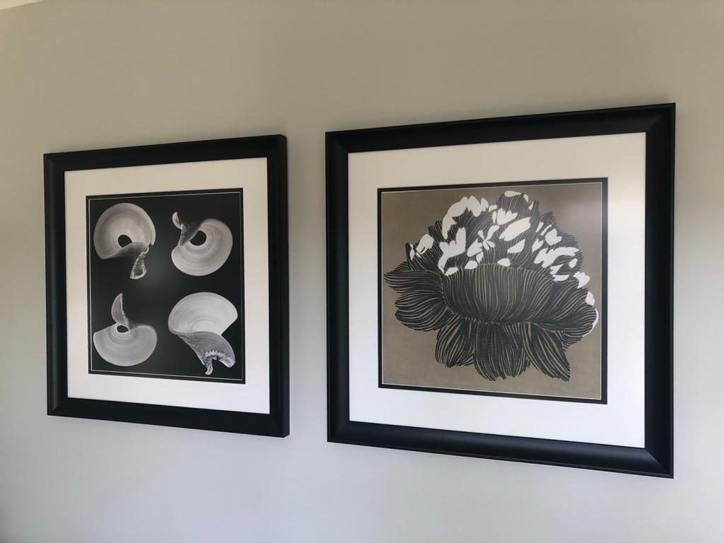 Gorgeous monochrome artwork of abstract shapes and a flower in black picture frames. In a house renovated by Absolute Project Management