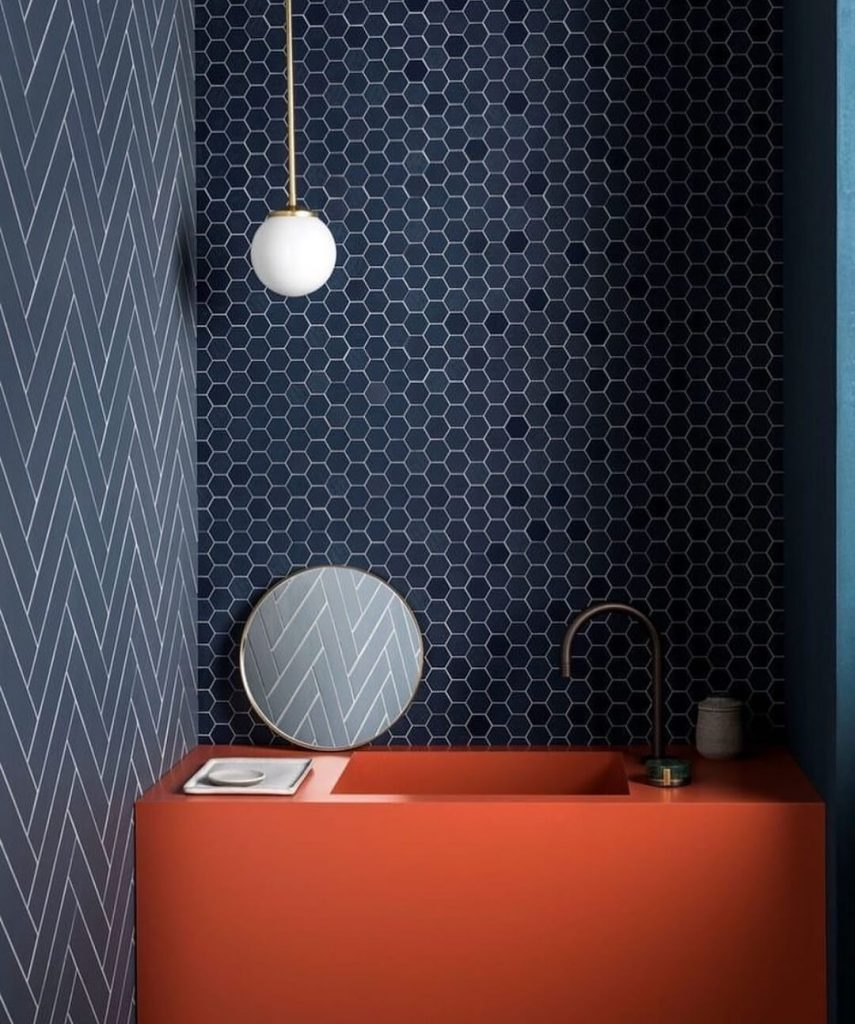 Opal bathroom light in navy blue bathroom with red bath by Spark & Bell