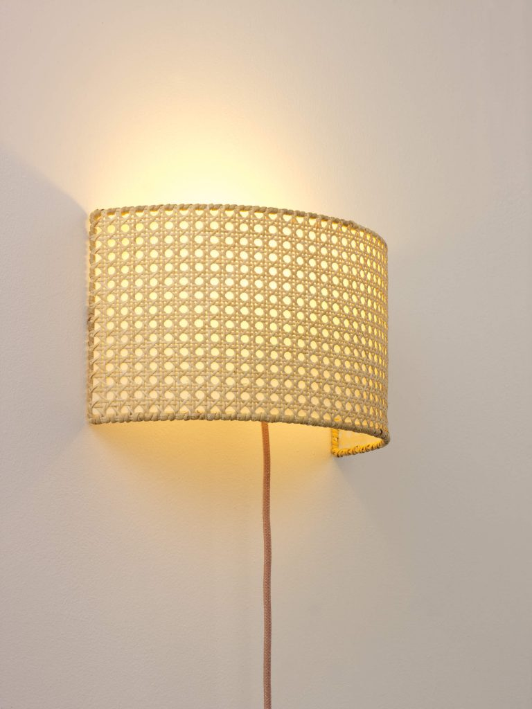 Rattan wall light by Spark & Bell