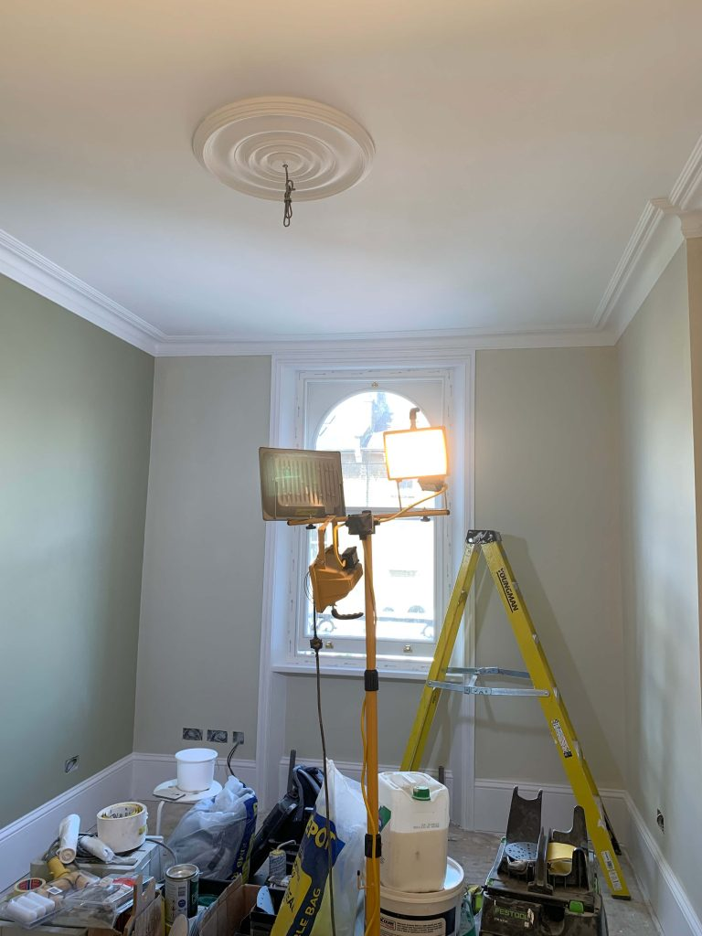 Light green nursery with ceiling rose, ladder and flood light