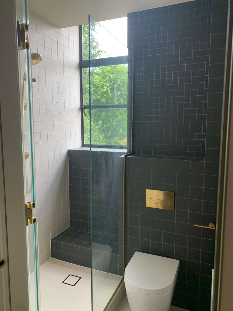 Bathroom with black and white tiles and brass fittings