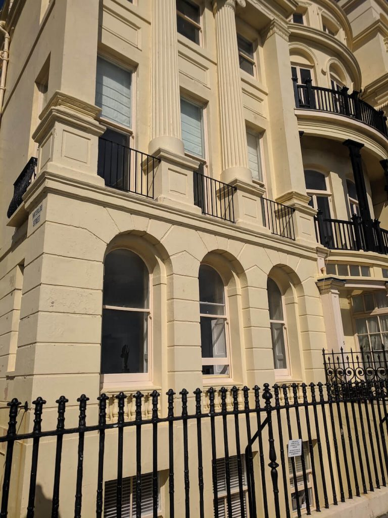 The pale yellow paintwork on the outside of a property in Brunswick Terrace, Brighton and Hove. Photo by Absolute Project Management.