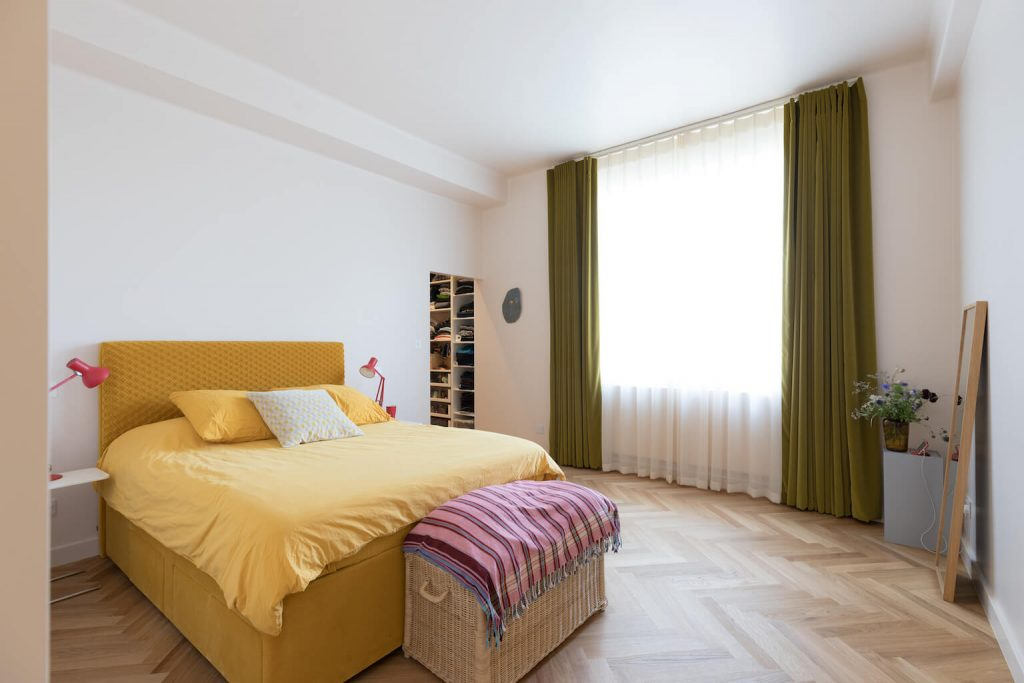 Bedroom with olive velvet curtains + parquet flooring, renovation by Absolute Project Management