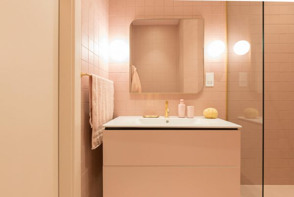 Blush + brass bathroom as part of 2 adjoining flats remodel and renovation by Absolute Project Management