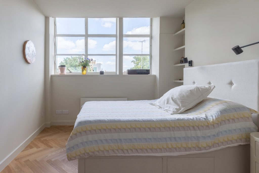 Bedroom with soft neutral tones + parquet flooring, renovation by Absolute Project Management