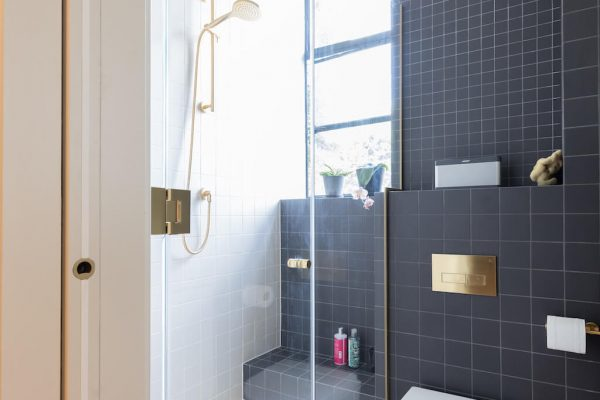 Black + brass bathroom as part of 2 adjoining flats remodel and renovation by Absolute Project Management