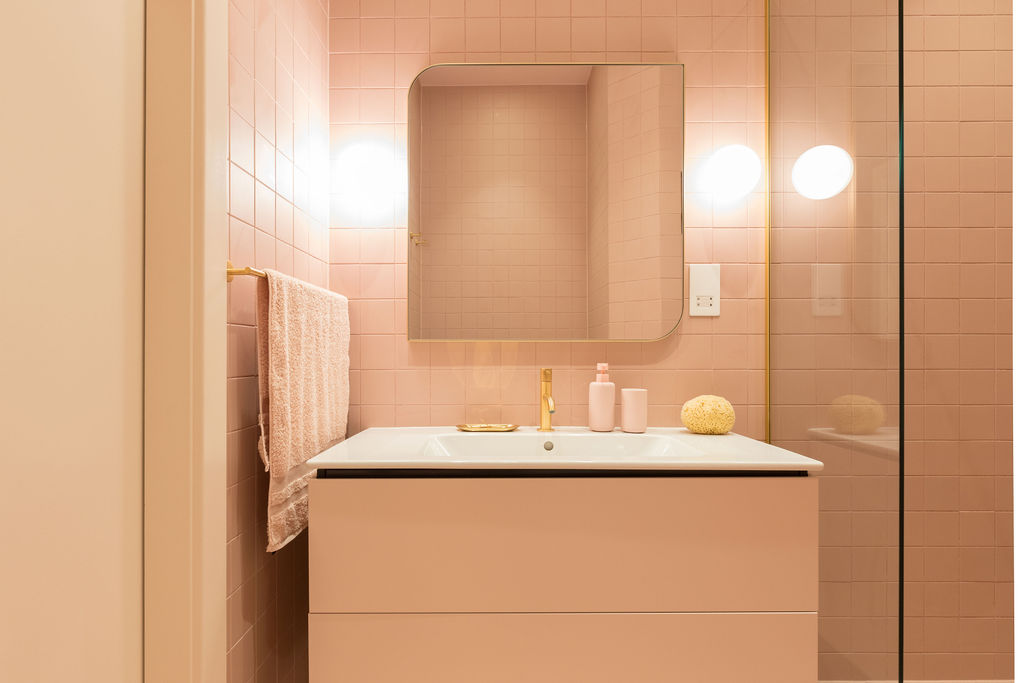 Bathroom with square pink tiles and matching vanity - renovation by Absolute Project Management