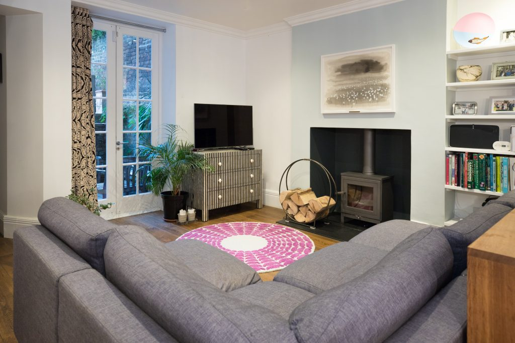 Wood burner in a living room. Renovation by Absolute Project Management.