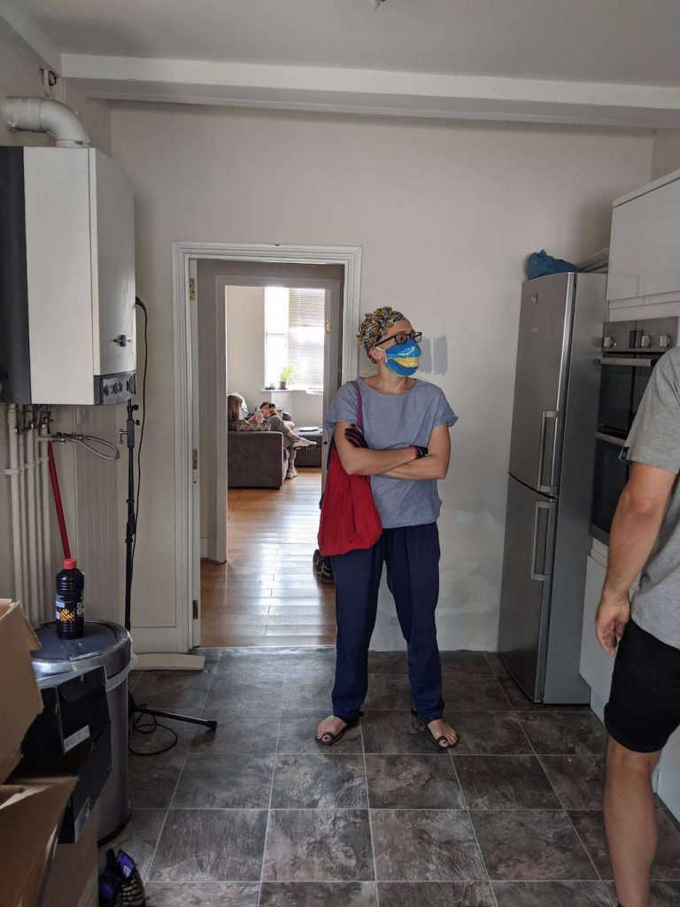 Person wearing a mask in a kitchen - viewing a house in Hove