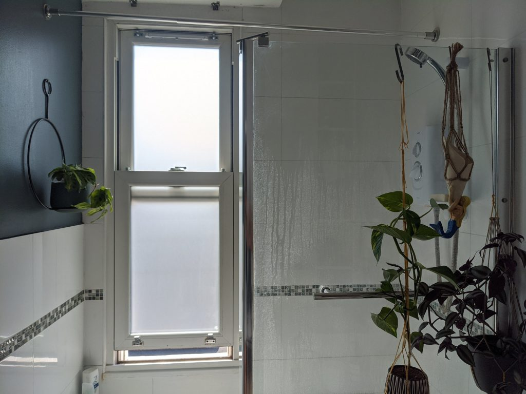 Purlfrost on bathroom sash window for privacy. Renovation by Absolute Project Management.
