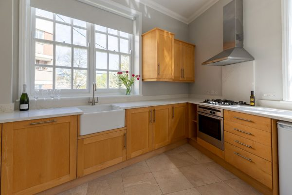 A new white quartz worktop gives this timber kitchen a wonderful facelift. Renovation by Absolute Project Management.
