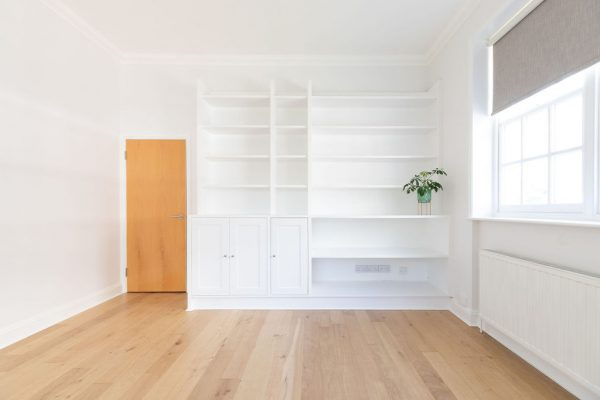 Freshly refurbished wood flooring and refreshed white joinery make this space a fresh and airy one to be in. Renovation by Absolute Project Management.