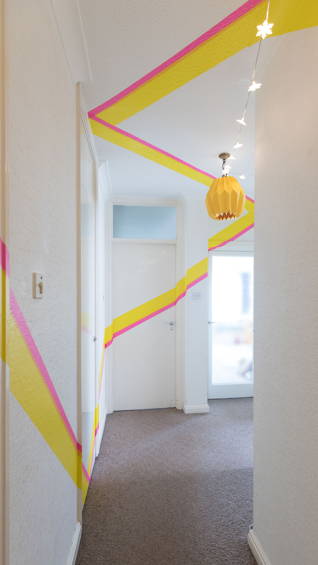 Colourful Washi tape adds a dash of colour and sense of real fun to this entryway. Renovation by Absolute Project Management.